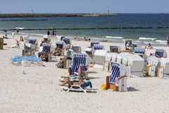Vacationers spend time on the beach in Kolobrzeg Royalty Free Stock Image
