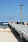 Vacationers strolls on the pier Stock Photo