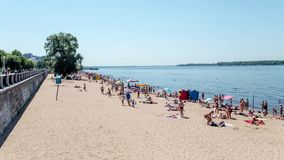 Vacationers Sunbathe on Sandy Beach of River Volga in Samara at Summer Day. Time Lapse stock video