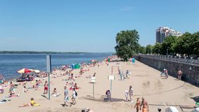 Vacationers Sunbathe on Sandy Beach of River Volga in Samara at Summer Day. Time Lapse stock video footage