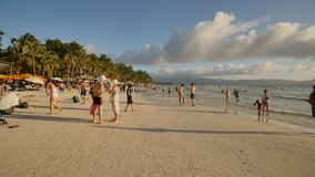 Boracay, Philippines - January 5, 2018: Vacationers on the sunny beach of the island of Boracay. Philippine exotic. Vacationers on the sunny beach of the island stock video