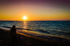 Vacationers On The Sunset Shore. Cinarcik town is a popular summer vacation area for the visitors coming from Istanbul city with the direct transportation Stock Photo