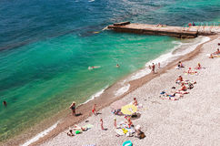 Vacationers swim and sunbathe on the Black Sea in Yalta Royalty Free Stock Images