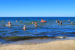 Vacationers swimming in shallow waters of the Baltic Sea Royalty Free Stock Image