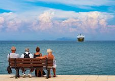 Vacationers tourists on the bench on the right tourist town of the Greek island of Kefalonia in Greece on the Ionian Sea coast in stock photo