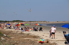 Vacationing families relaxing on the beaches of St.Simons Island,Georgia,April,2015. Peaceful scene of families and other vacationers enjoying a relaxing day on Stock Photos