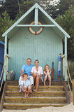 Vacationing Family Sitting In Beach Hut Royalty Free Stock Photography