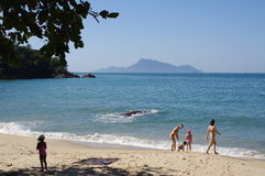 Vacationing tourist at exotic beach. At Ilha Grande on the Green coast south of Rio de Janeiro in Brazil Stock Photo