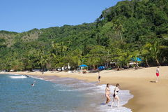 Vacationing tourist at exotic beach. At Ilha Grande on the Green coast south of Rio de Janeiro in Brazil Royalty Free Stock Photos