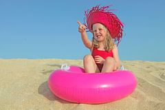 vacations. Happy kid on vacations on beach pointing at bland copy space Royalty Free Stock Photo