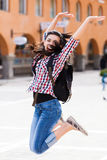 Vacations. Happy tourist jumping of joy in the center of the vicited city Stock Photos