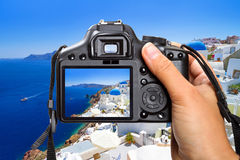 Vacations on Santorini island with the camera Royalty Free Stock Photography