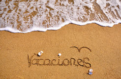 Vacations sign on the beach Royalty Free Stock Photography