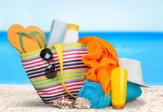 Vacations. Summer beach bag sunglasses fun suntan lotion flip-flop stock images