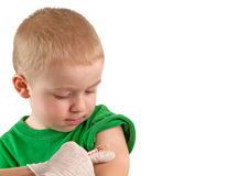 Vaccinating a child. Macro photograph of a doctor vaccinating a child royalty free stock images