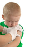 Vaccinating a child. Macro photograph of a doctor vaccinating a child royalty free stock image
