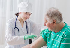 Vaccinating An Elderly Person Royalty Free Stock Photos