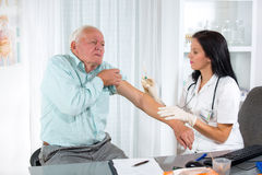 Vaccinating An Elderly Person Royalty Free Stock Image