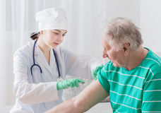 Vaccinating An Elderly Person Royalty Free Stock Images