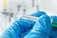 Vaccination difficile de clostridium Photographie stock