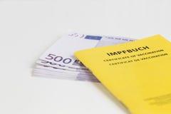 Vaccination pass on 500 Euro notes Stock Photos