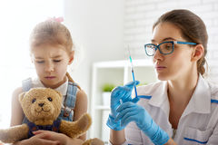 A vaccination to a child Stock Photos