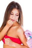 Vaccination of young beautiful woman. Isolated on white background Stock Photography