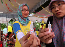 Vaccine. Medics prepare polio vaccine at a health post in the city of Solo, Central Java, Indonesia Royalty Free Stock Photos