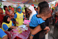 Vaccine. Medics prepare polio vaccine at a health post in the city of Solo, Central Java, Indonesia Stock Photography