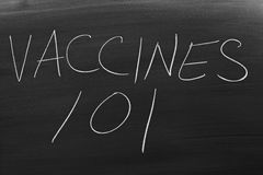 Vaccines 101 On A Blackboard Stock Images
