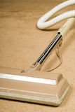 Vaccum Cleaner. An old vacuum cleaner on resting unused on the carpet Royalty Free Stock Photo