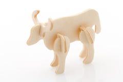 Vache en bois à jouet image stock