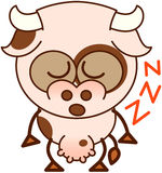 Vache mignonne dormant placidement Image libre de droits