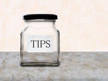 Vacie el tarro de las extremidades en contador Ningún dinero Imágenes de archivo libres de regalías
