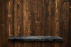 Vacie el top de la tabla de piedra de mármol negra en backg de madera de la pared del tablón fotografía de archivo libre de regalías