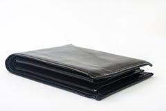 Vacie la cartera de cuero negra en un fondo blanco Foto de archivo libre de regalías
