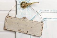 Vacie la escritura de la etiqueta en una maneta de puerta Foto de archivo