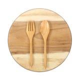 Vacie la placa y las cucharas de madera, bifurcaciones en el fondo blanco Fotografía de archivo