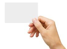 Vacie la tarjeta de visita en la mano de una mujer Foto de archivo
