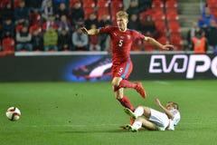 Vaclav Prochazka and Arturs Zjuzins. Match of EURO 2016 qualification group A Czech Republic - Latvia 1:1 (0:1). Goals 90' Pilař - 30' Višnakovs Royalty Free Stock Photos