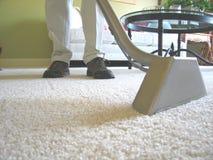 Vacío de la limpieza de la alfombra Foto de archivo