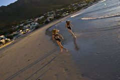 Seaside Vaction. Fun at the ocean, early evening, leaving fresh footprints in the sand. Gordons Bay - South Africa Stock Image