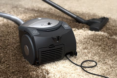 Vacuum cleaner. Thorough cleaning of carpets Stock Photos
