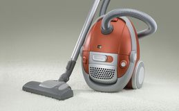 Vacuum cleaner. Red vacuum cleaner on a carpet Royalty Free Stock Images
