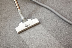 Vacuum cleaner. In the action isolated on the floor Royalty Free Stock Photo
