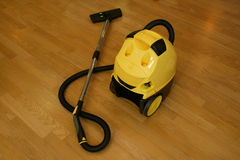 Vacuum-cleaner. Yellow vacuum-cleaner on the floor Royalty Free Stock Photo