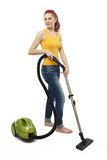 Vacuum cleaner. Young woman with a green vacuum cleaner isolated on white Royalty Free Stock Photo