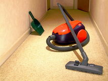 Vacuum Cleaner. A hose-type vacuum cleaner sitting in a passageway stock photo
