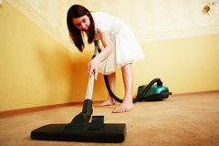 Vacuum cleaner. Beautiful girl in a interior Royalty Free Stock Image