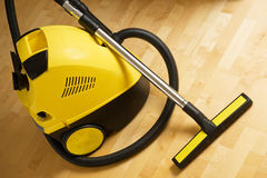 Vacuum cleaner. On a wooden floor Royalty Free Stock Image